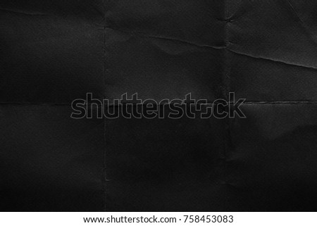 Black paper background. Old texture. Crumpled texture. Fold Royalty-Free Stock Photo #758453083