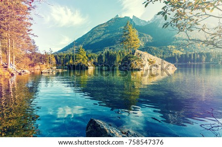 Wonderful nature scene, pine trees on a rock island at sunset, glowing in sunlight, The  Lake Hintersee. Nationalpark Berchtesgadener Land, Upper Bavaria, Germany.  retro style, instagram filter,  #758547376