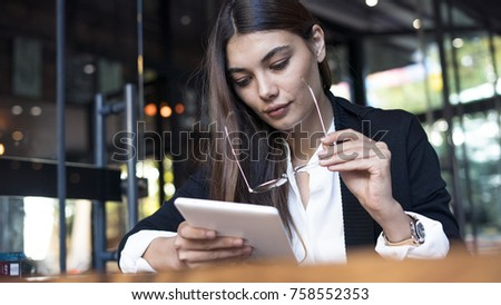 Young woman using digital tablet #758552353