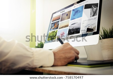 Graphic designer checking online portfolio website. All screen graphics are made up.