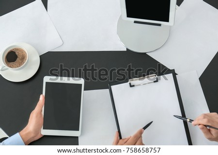 Office employees working with documents at desk #758658757