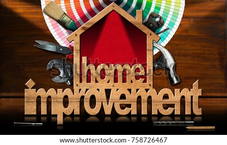 Home improvement - Wooden symbol in the shape of a house with a work tools and a color palette on a wooden desk #758726467