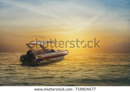 Speedboat is in the sea in beautiful sunset. Royalty-Free Stock Photo #758804677