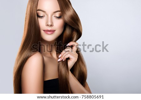 Beautiful model girl with shiny brown and straight long  hair . Keratin  straightening . Treatment, care and spa procedures. Smooth hairstyle Royalty-Free Stock Photo #758805691