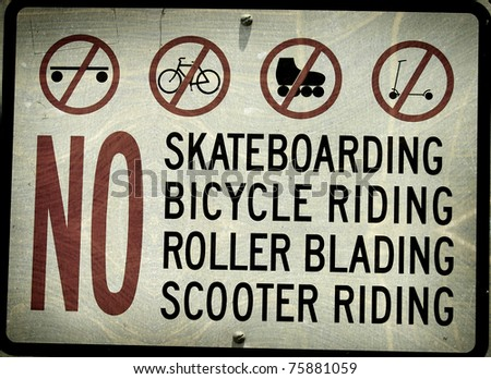aged and worn vintage photo of sign prohibiting skateboarding #75881059