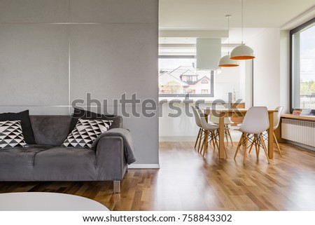 Home interior with gray couch, wooden table and modern lamps #758843302
