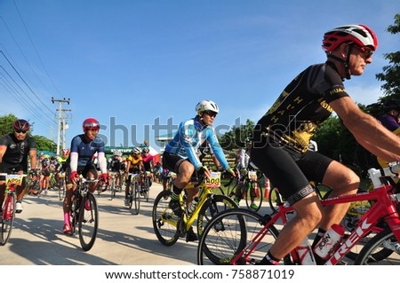"""2017 Nov 19 A group of athletes competing in the charity program for children with visual disabilities, """"Spinning your baby at the end of the first winter rain"""". Mon Channel at Khao Yoi, thailand. #758871019"""