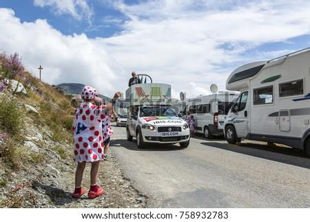 COL CROIX DE FER, FRANCE- JUL 25: Kids in Polka-Dot Jersey enjoying the passing of the Publicity Caravan on the road to the Col de la Croix de Fer in Alps during the stage 20 of Le Tour de France 2015 #758932783