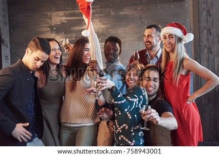 Party with friends. They love Christmas. Group of cheerful young people carrying sparklers and champagne flutes dancing in new year party and looking happy. Concepts about togetherness lifestyle. #758943001
