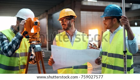 Group of engineering team had meeting at working site #759027577