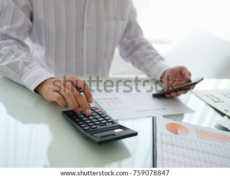 Businessman reviewing data in financial statement and assessment business. Accounting , Accountancy, Bookkeeping Concept. #759078847