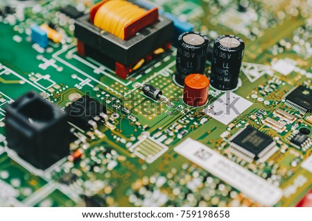 Detail of an electronic printed circuit board with many electrical components #759198658