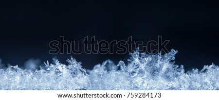 Super macro horizontal composite panorama of snow-flakes in snowdrift