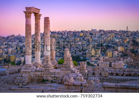 Amman, Jordan its Roman ruins in the middle of the ancient citadel park in the center of the city. Sunset on Skyline of Amman and old town of the city with nice view over historic capital of Jordan. #759302734