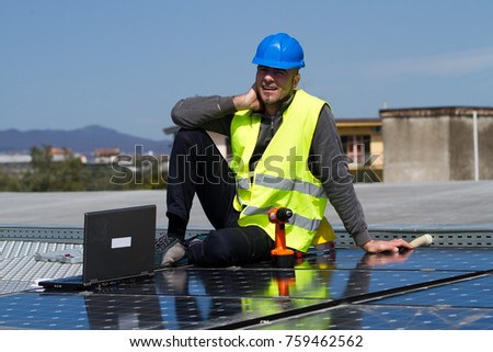 fitting photovoltaic panels on a roof  of a building #759462562