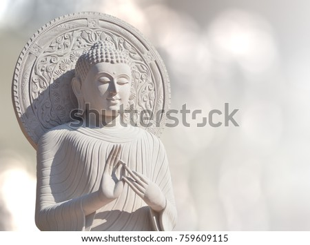 The White Stone Buddha Statue With Light Bokeh background in BanDen temple in Chiang Mai, Thailand for background or textures and other. Close up.