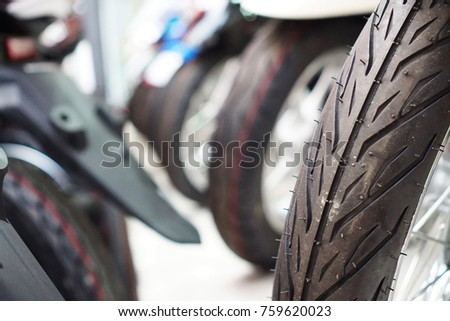 Close up motorcycle wheel parking on the street.  motorcycle in a row