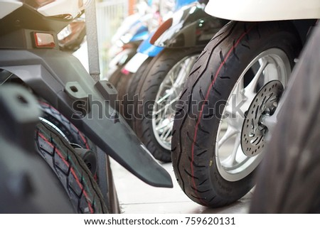 Close up motorcycle wheel parking on the shop.  motorcycle in a row. Transportation and industry concept