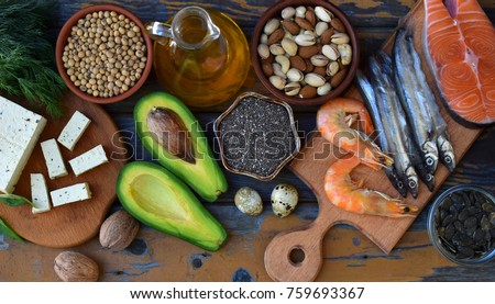 Composition of products containing unsaturated fatty acids Omega 3 - fish, nuts, tofu, avocado, eggs, soybeans, pumpkin seeds, chia, hemp, dill, vegetable oil. Top view. Healthy food #759693367