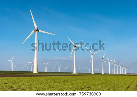 Offshore Windmill farm in the ocean  Westermeerwind park , windmills isolated at sea on a beautiful bright day Netherlands Flevoland Noordoostpolder #759730900