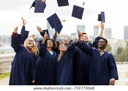 education, graduation and people concept - group of happy international students in bachelor gowns throwing mortar boards up in the air #759773068