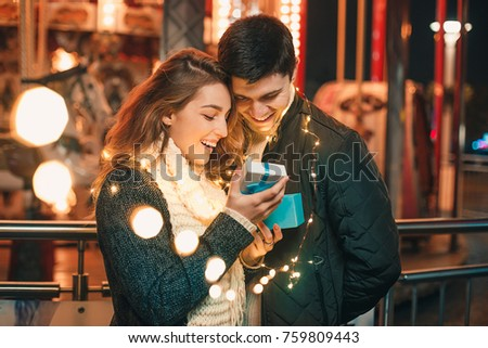 romantic surprise for Christmas, woman receives a gift from her boyfriend #759809443