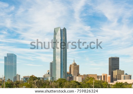 Skyline of Oklahoma City, OK during the day with cloudly sky