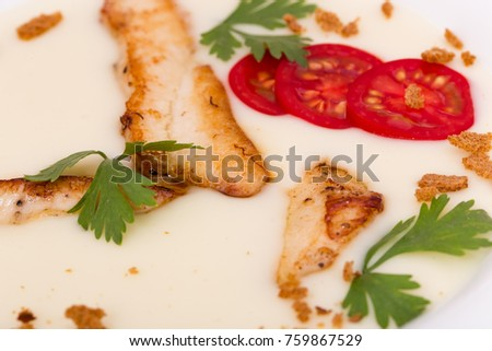 Cream soup with grilled chicken filletand sliced tomatoes   #759867529
