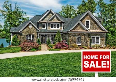 Beautiful Home with For Sale Sign in Front Yard