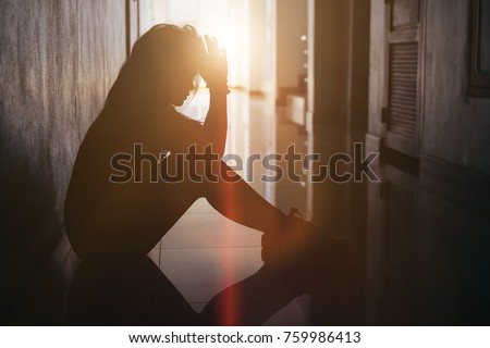 Silhouette of sad and depressed women sitting at walkway of condominium or office with backlit and lens flare,sad mood,feel tired, lonely and unhappy. #759986413
