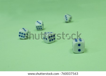 rolling the dice on a light green background. #760037563