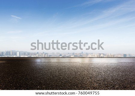 empty asphalt road and cityscape of shaoxing in blue foggy sky #760049755