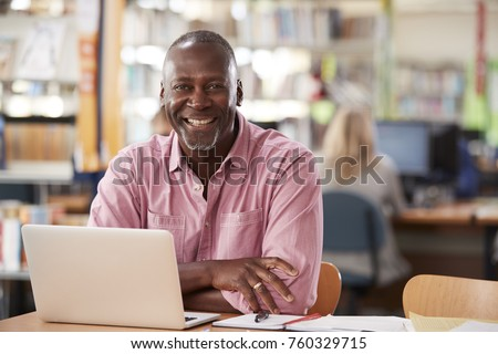 Portrait Of Mature Male Student Using Laptop In Library #760329715