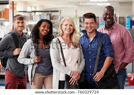 Portrait Of Mature Student Group Standing In Library #760329724