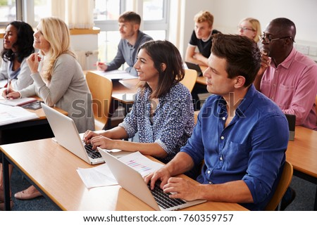 Mature Students Sitting At Desks In Adult Education Class #760359757
