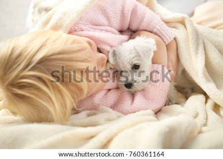 Little cute girl with puppy at home #760361164