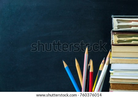 Pencils and books with chalkboard background. Education concept. #760376014