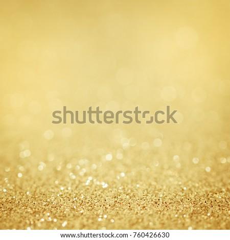 Background gold glitter. Golden abstract christmas light