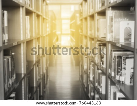 Blured black and white image of Bookshelf Research of Education in library
