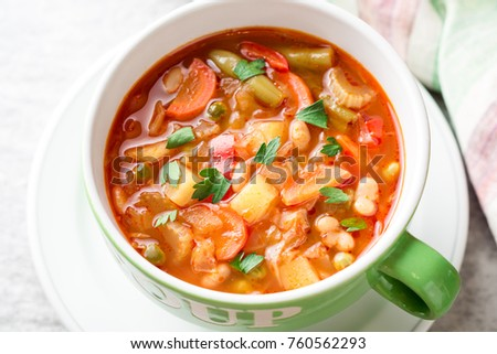 Italian minestrone soup in bowl on gray stone background. Selective focus. #760562293