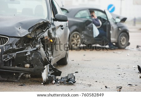 car crash accident on street, damaged automobiles after collision in city Royalty-Free Stock Photo #760582849