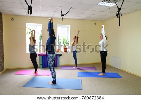 Group of four people performs basic exercises from yoga. European girls doing weight loss exercises. Concept of group sports, exercises to restore physical form. #760672384
