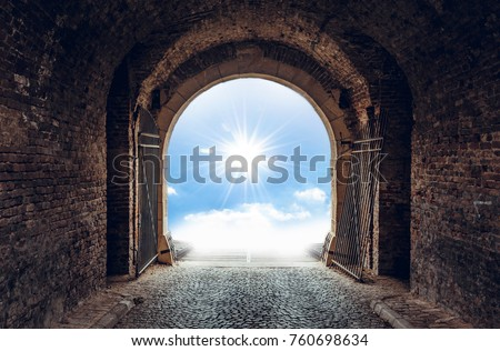 Old tunnel with light on the end of road #760698634