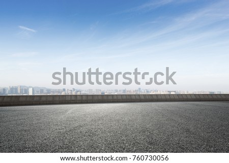 empty asphalt road and cityscape of shaoxing in blue foggy sky #760730056