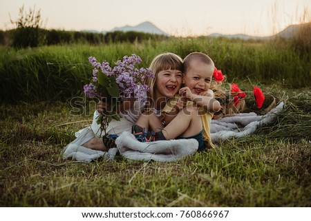 funny siblings playing and laughing outdoors #760866967