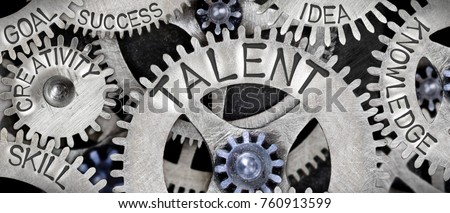 Macro photo of tooth wheel mechanism with TALENT concept related words imprinted on metal surface Royalty-Free Stock Photo #760913599