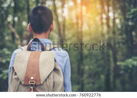 Happy Boys tourist to travel in wild trip  hiking during vacation.Travel concept. #760922776