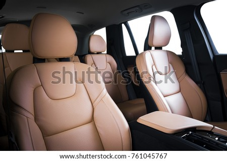 Luxury car inside. Interior of prestige modern car. Comfortable leather seats. Red perforarated leather cockpit with isolated white background. Royalty-Free Stock Photo #761045767