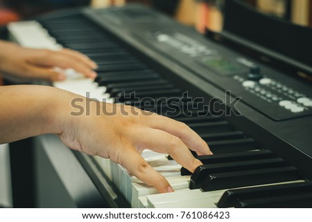 Hand touch on electronic piano , Fingers click on pad of keyboard. #761086423