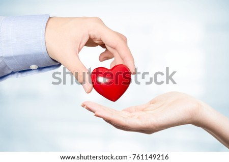 Hand holding red heart. Health care medicine and life concept #761149216